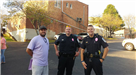 Police Officers with Family Resource Center Staff Member